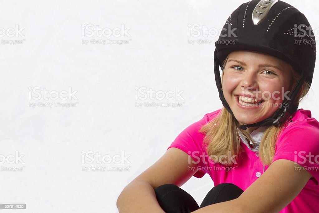 young teenage girl wearing riding clothes stock photo