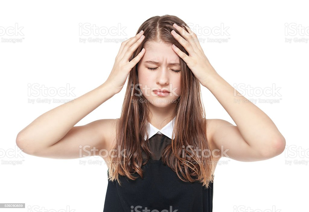 Young teenage girl with headache isolated stock photo