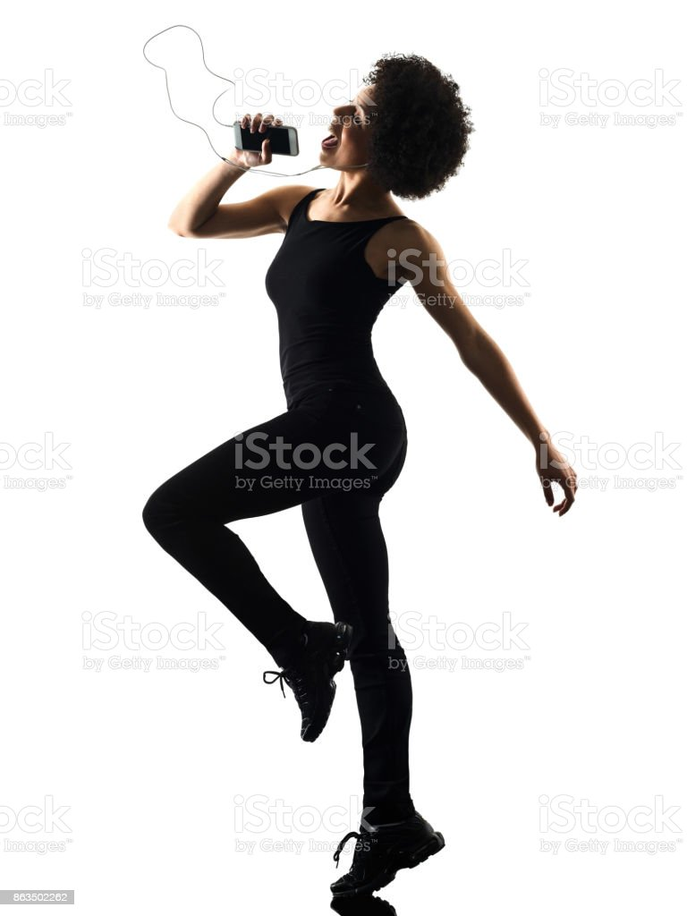 young teenager girl woman happy dancer dancing listening music i stock photo