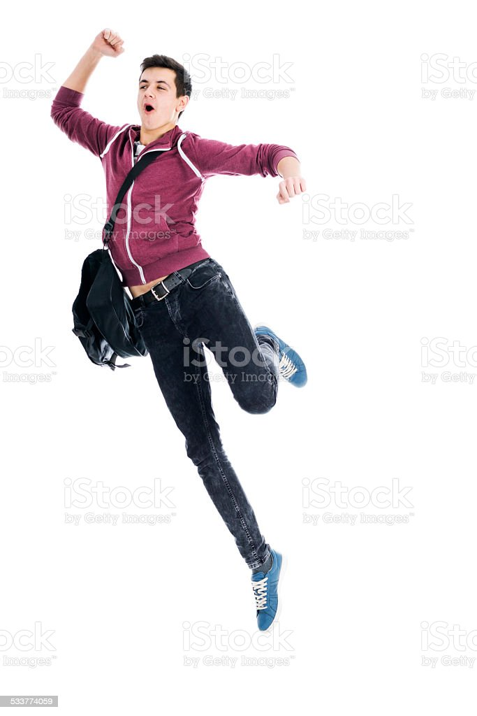 Young teenager jumping in the air stock photo