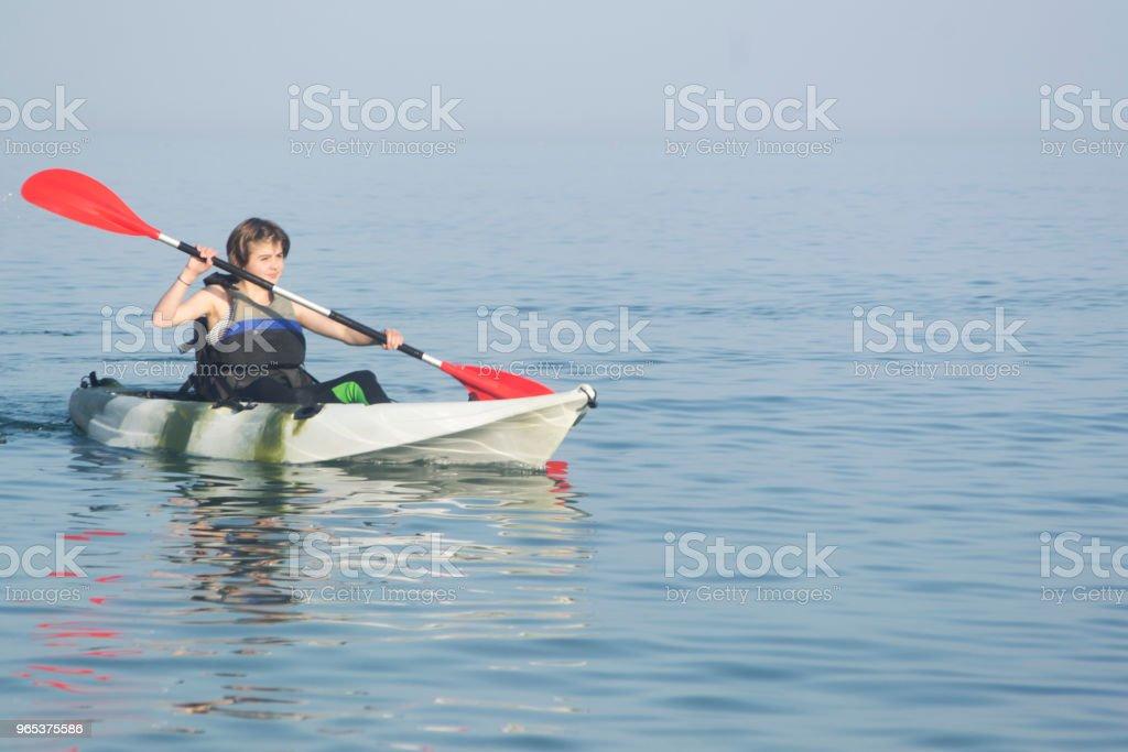 Young teenager kayaking royalty-free stock photo