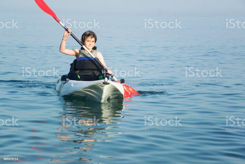 Young teenager kayaking zbiór zdjęć royalty-free