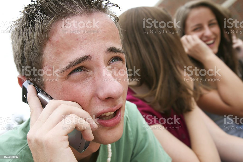 Young Teenager on His Cell Phone royalty-free stock photo