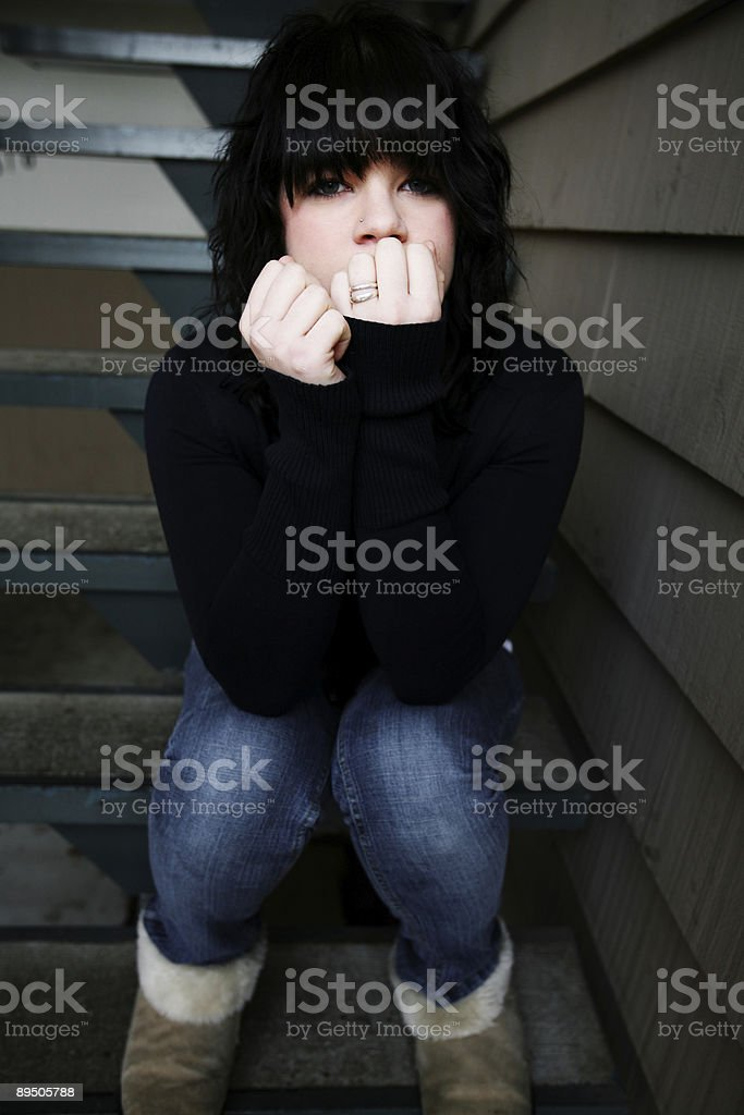 Young Teenager Sitting on Stairs Portrait royalty-free stock photo