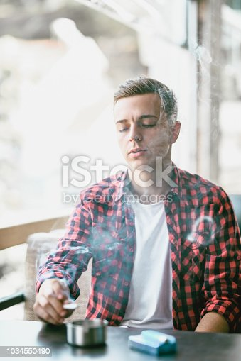 Young Teenager Skips Class and Smoke Cigarettes in Coffee Bar