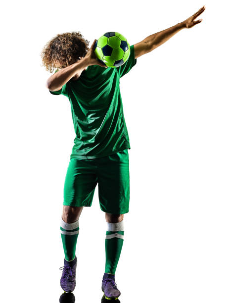 young teenager soccer player man silhouette isolated celebration stock photo
