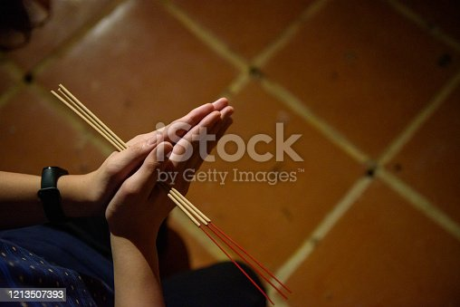 Young teenager worshiping in temple