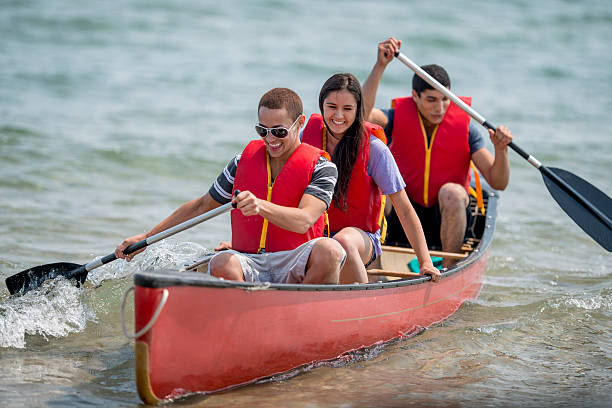 Young Teenagers on a Canoe Trip stock photo