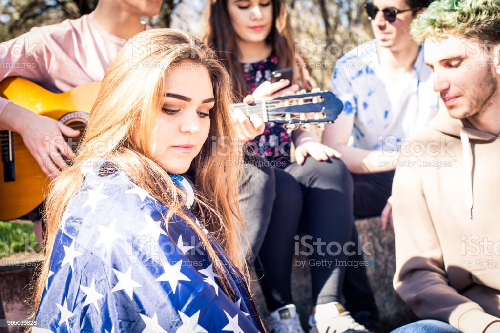 Young teenagers with american flag honoring our troops and memorial day zbiór zdjęć royalty-free