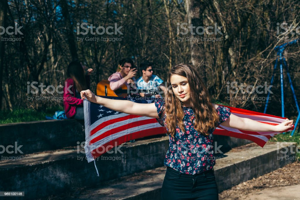 Young teenagers with american flag honoring our troops and memorial day royalty-free stock photo