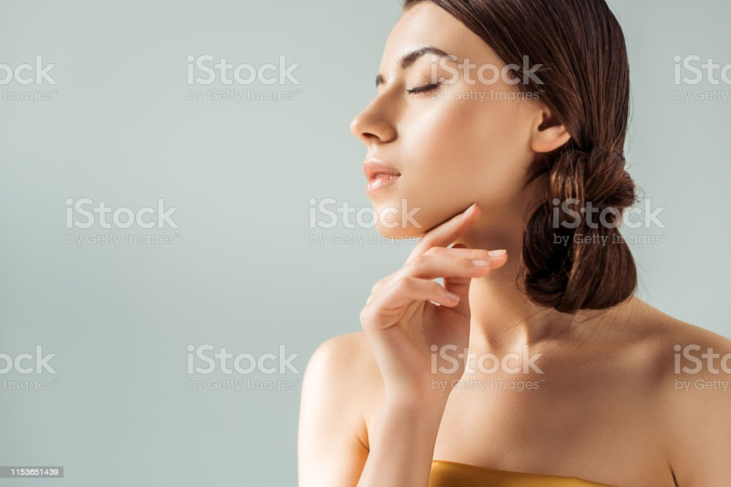 young tender woman with closed eyes, shiny lips and golden eye shadow...