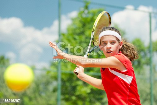 Young tennis champion, hitting forehand