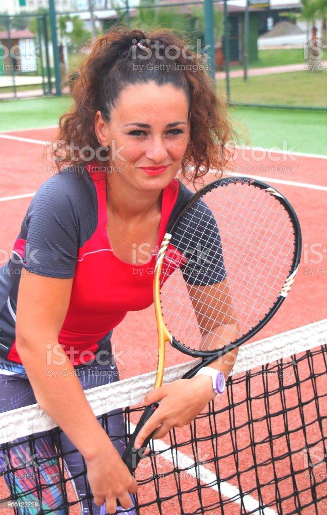 Junge Tennis Trainer Frau schießen - Lizenzfrei Aktivitäten und Sport Stock-Foto