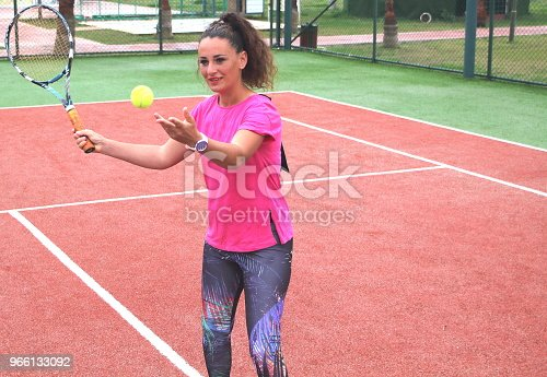 photoshooting of a young woman on tennis cour