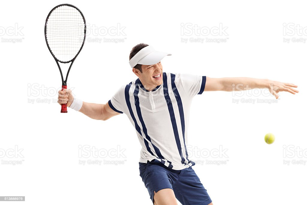 Young tennis player hitting a return stock photo