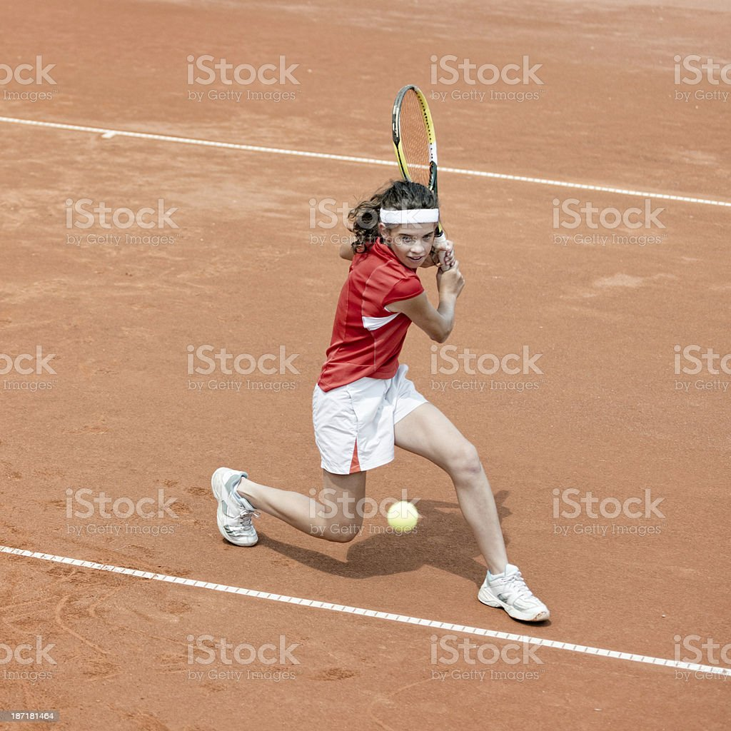 Young tennis player in action royalty-free stock photo