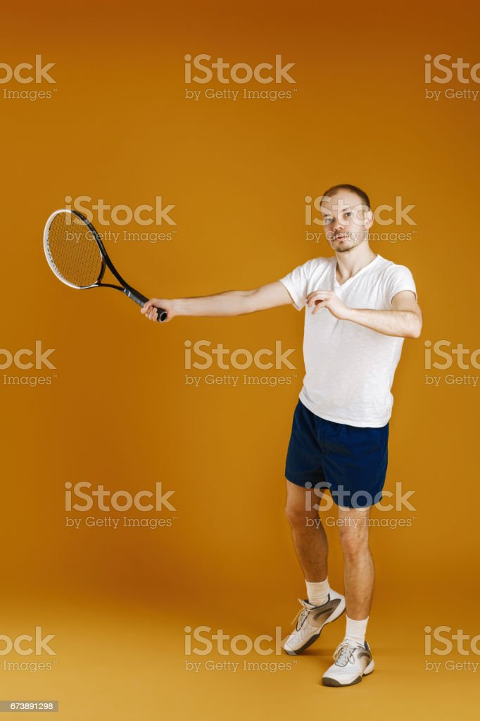 young tennis player plays tennis on yellow background foto de stock royalty-free