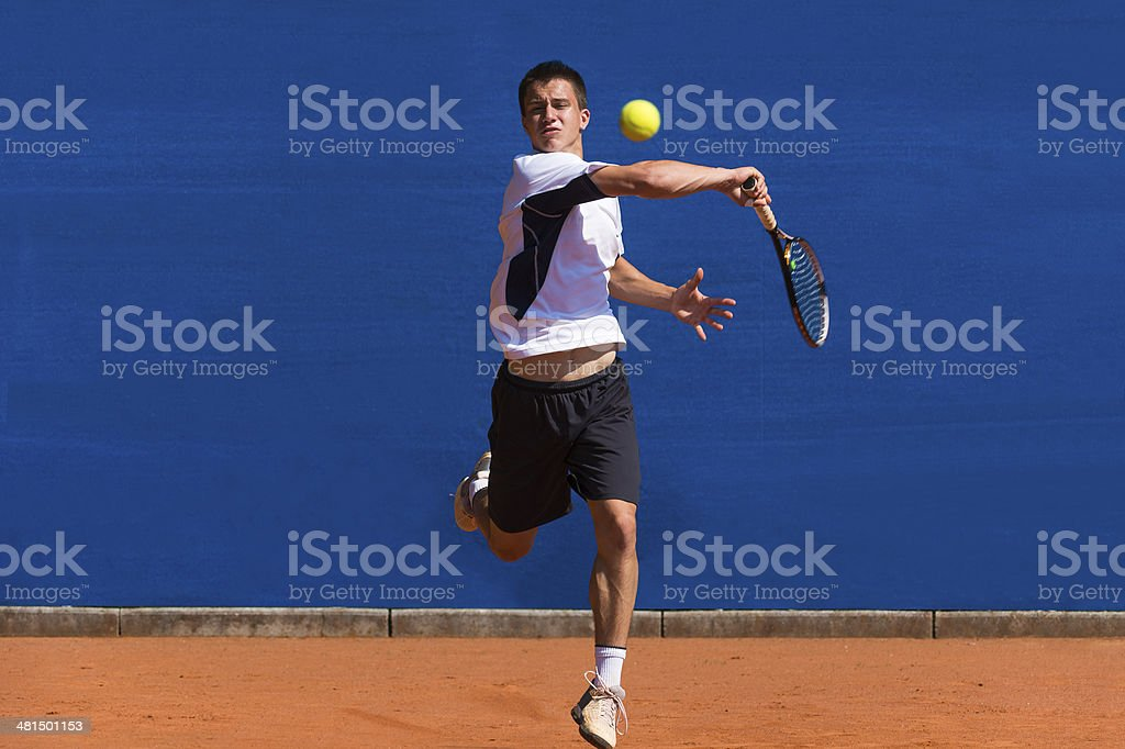 Young Tennis Player Practicing Forehand Drive stock photo