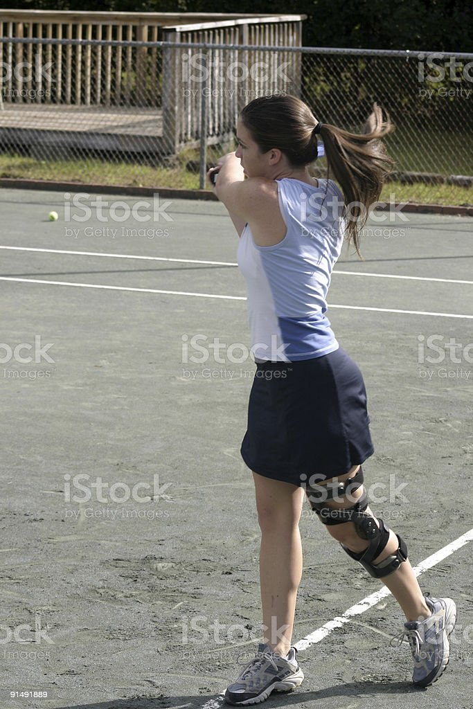 young tennis player wearing knee brace royalty-free stock photo