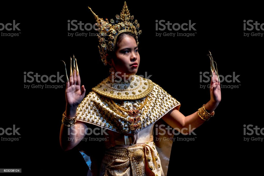 Young Thai woman performing classical dance in traditional costume. stock photo