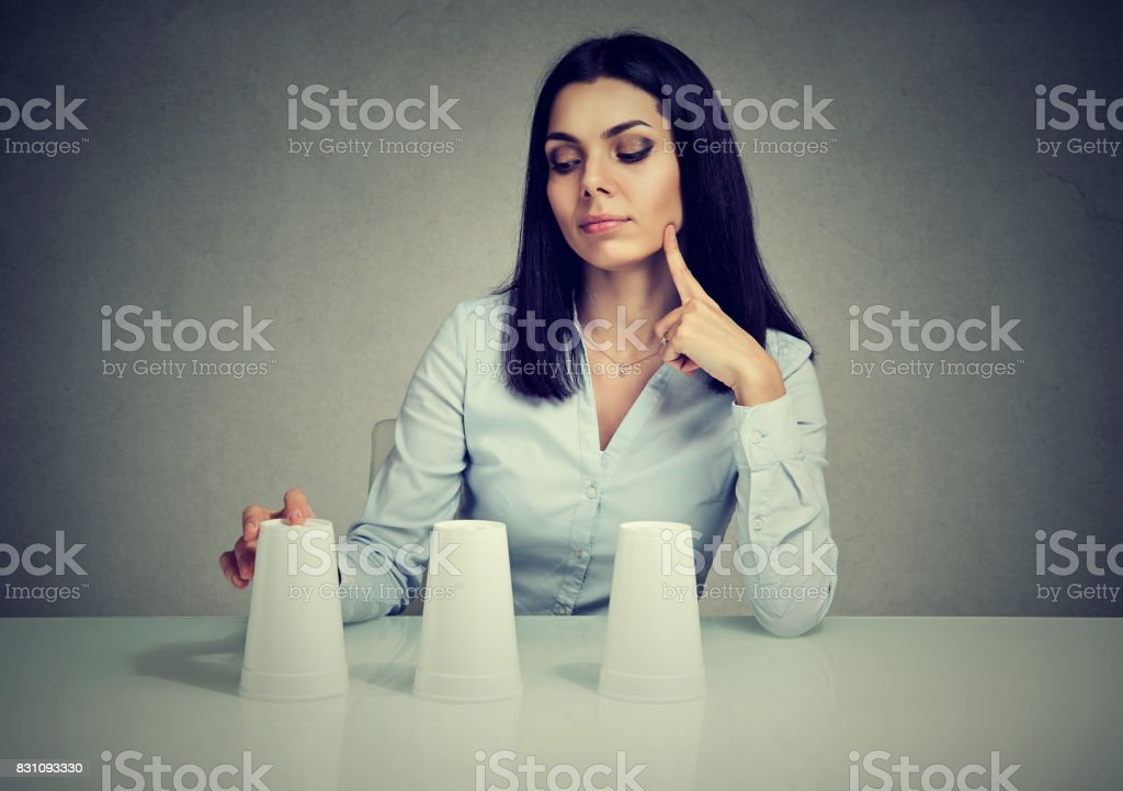 Young thoughtful woman playing a conjuring trick game stock photo