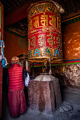 istock A young Tibetan Buddhist monk turning the prayer wheels, Lo Manthang, Upper Mustang, Nepal 1251364888