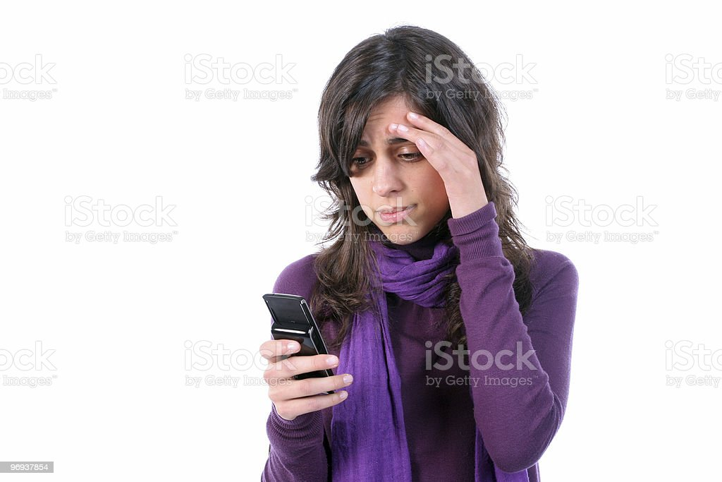 Young tired and with headache, reading a sms royalty-free stock photo