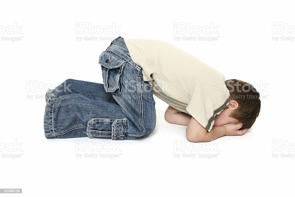 Young toddler boy in jeans having a temper tantrum on white stock photo