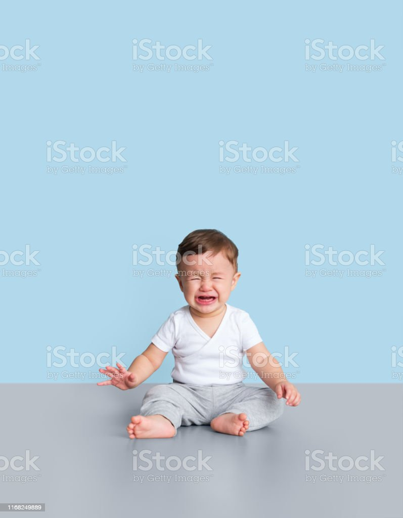 Young toddler crying Crying, Baby - Human Age, Screaming, Babies Only, Males 6-11 Months Stock Photo