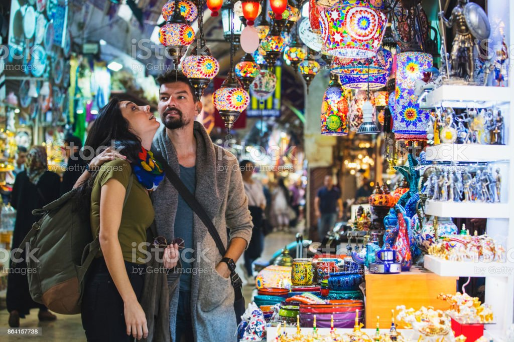 Young tourist couple shopping in in Grand Bazaar, Istanbul, Turkey royalty-free stock photo
