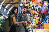 Young tourist couple shopping in in Grand Bazaar, Istanbul, Turkey