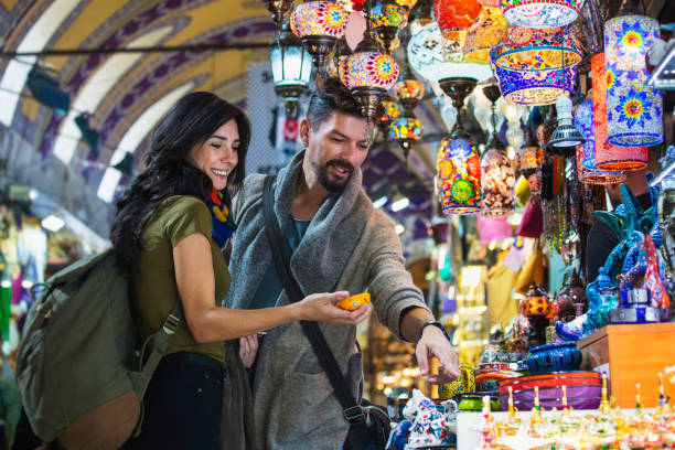 Young tourist couple shopping in in Grand Bazaar, Istanbul, Turkey Young tourist couple shopping in in Grand Bazaar, Istanbul, Turkey shopping couple asian stock pictures, royalty-free photos & images
