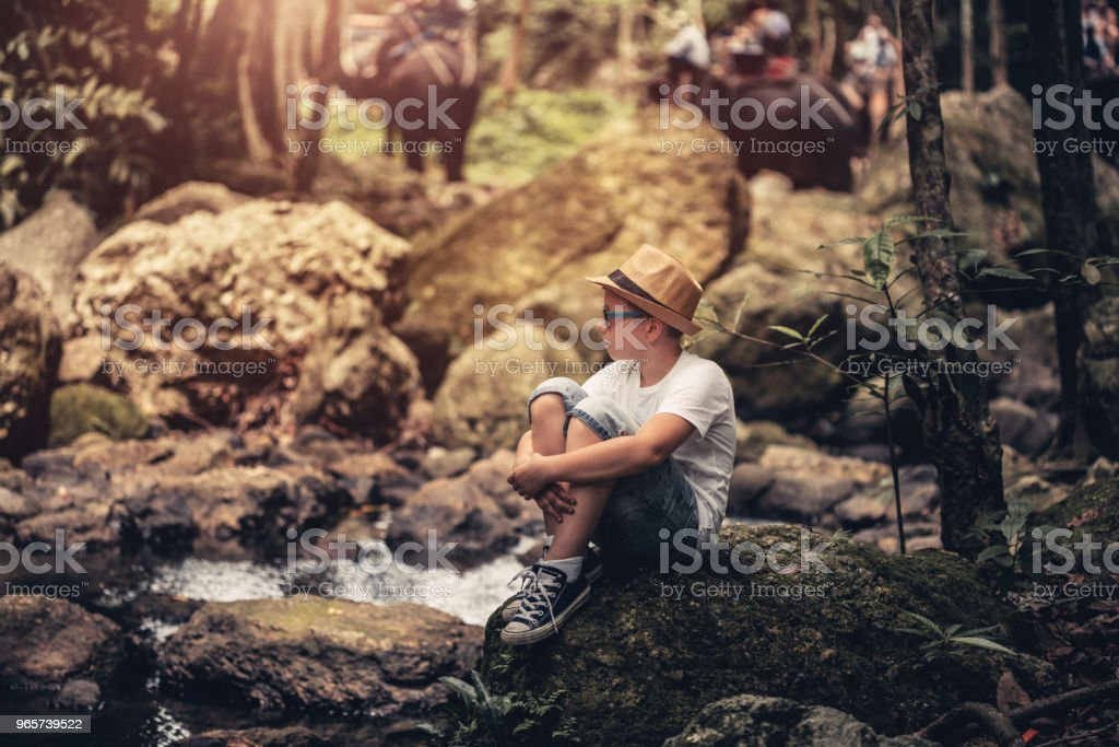 Young tourist exploring jungle - Royalty-free Adult Stock Photo