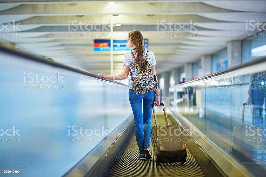 Young tourist girl in international airport stock photo
