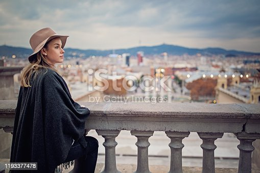 Young tourist girl is enjoying the city view