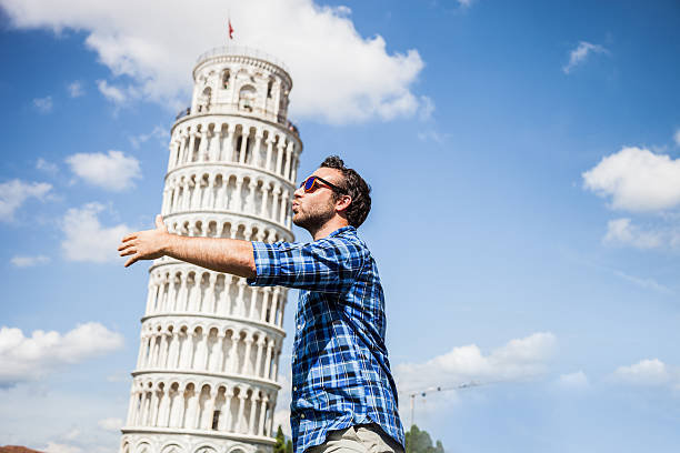 Young tourist having fun in Pisa Young tourist having fun in Pisa close to the leaning tower. pisa stock pictures, royalty-free photos & images