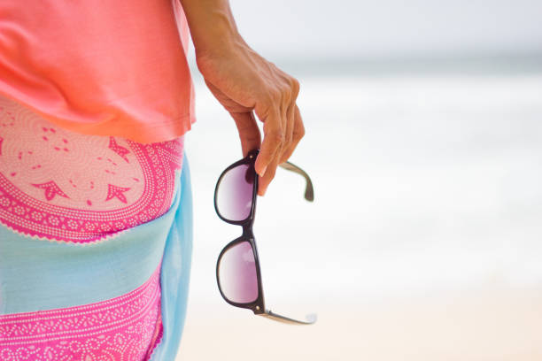 Young tourist holding a polarized sunglasses stock photo