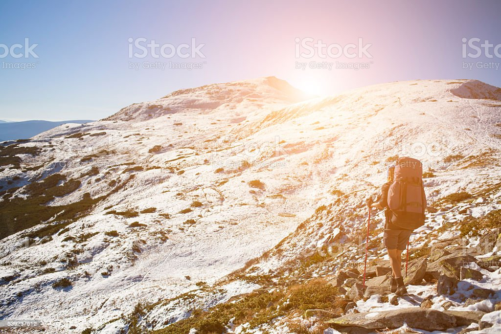 Young tourist in the mountains. royalty-free stock photo
