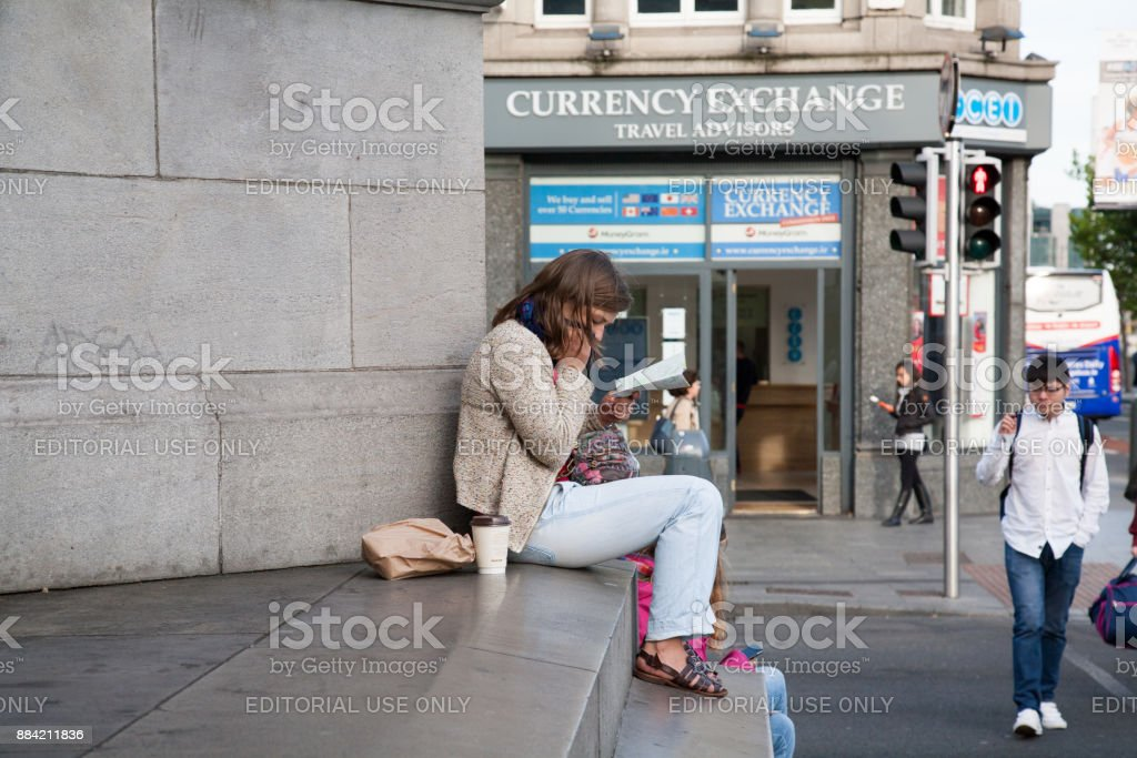 Young Tourist looking at map at O'Connell Monument stock photo