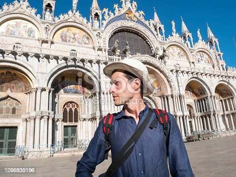 Young tourist man in Venice, in Piazza San Marco, in front of the basilica of San Marco