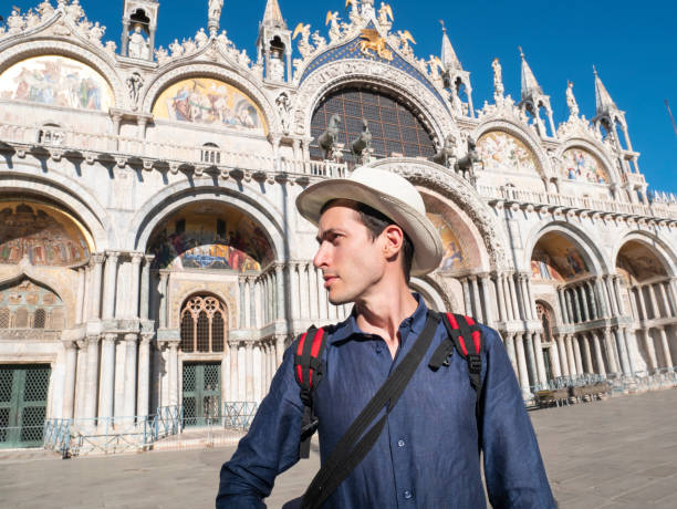 Young tourist man in Venice, in Piazza San Marco, in front of the basilica of San Marco stock photo