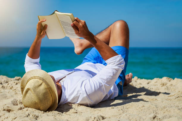 881 Man Reading Book On Beach Stock Photos, Pictures & Royalty-Free Images  - iStock