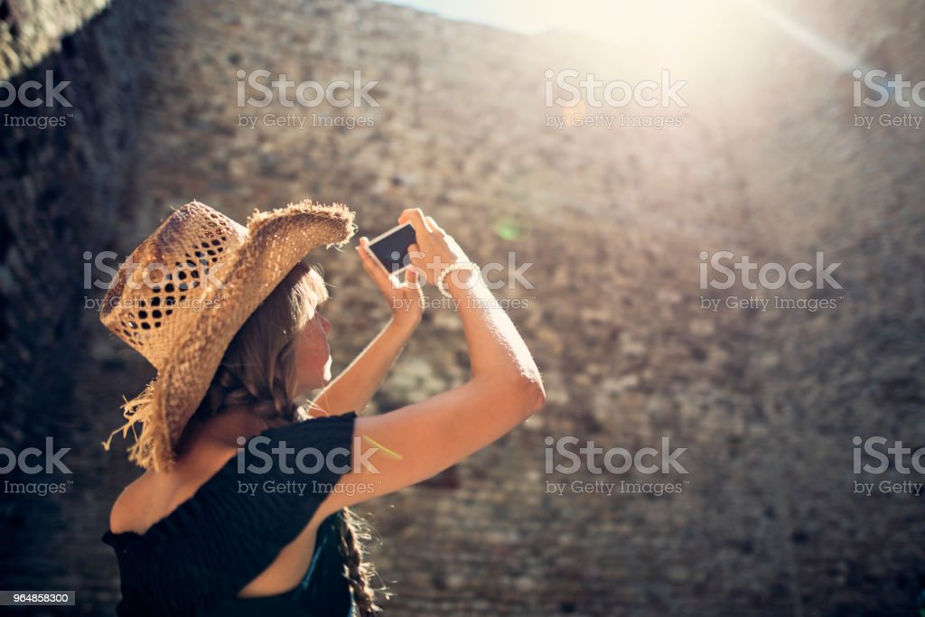 Young tourist photographing castle ruins royalty-free stock photo
