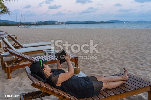 Young tourist use tablet on the beach