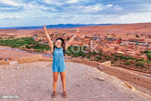 872393896istockphoto Young tourist visiting Ait Benhaddou - Ancient city in Morocco North Africa 986294104