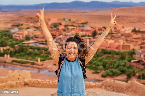 872393896istockphoto Young tourist visiting Ait Benhaddou - Ancient city in Morocco North Africa 986294214