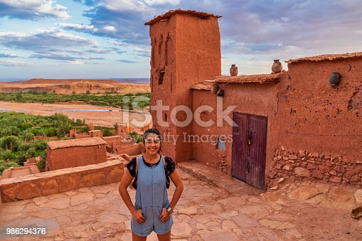 872393896istockphoto Young tourist visiting Ait Benhaddou - Ancient city in Morocco North Africa 986294376