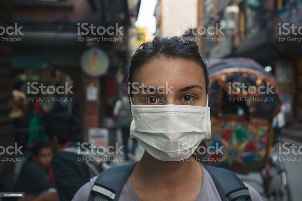Young tourist with mask stock photo