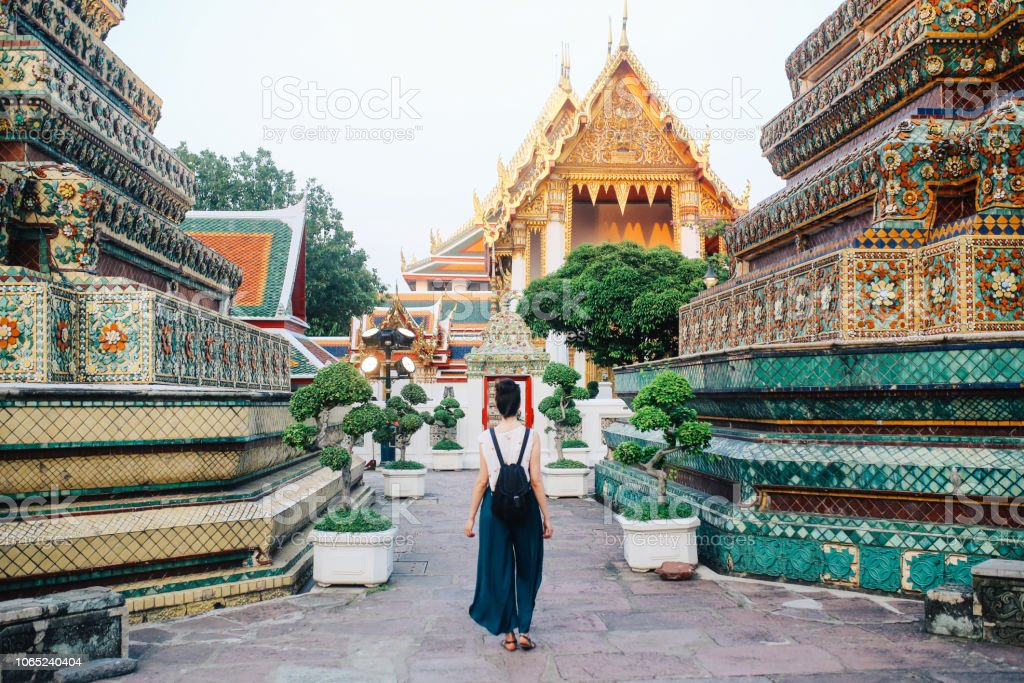 Young tourist woman in famous Bangkok Wat Pho temple stock photo
