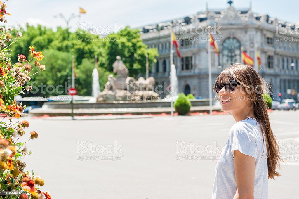 Young tourist woman in front Cibeles Fountain stock photo